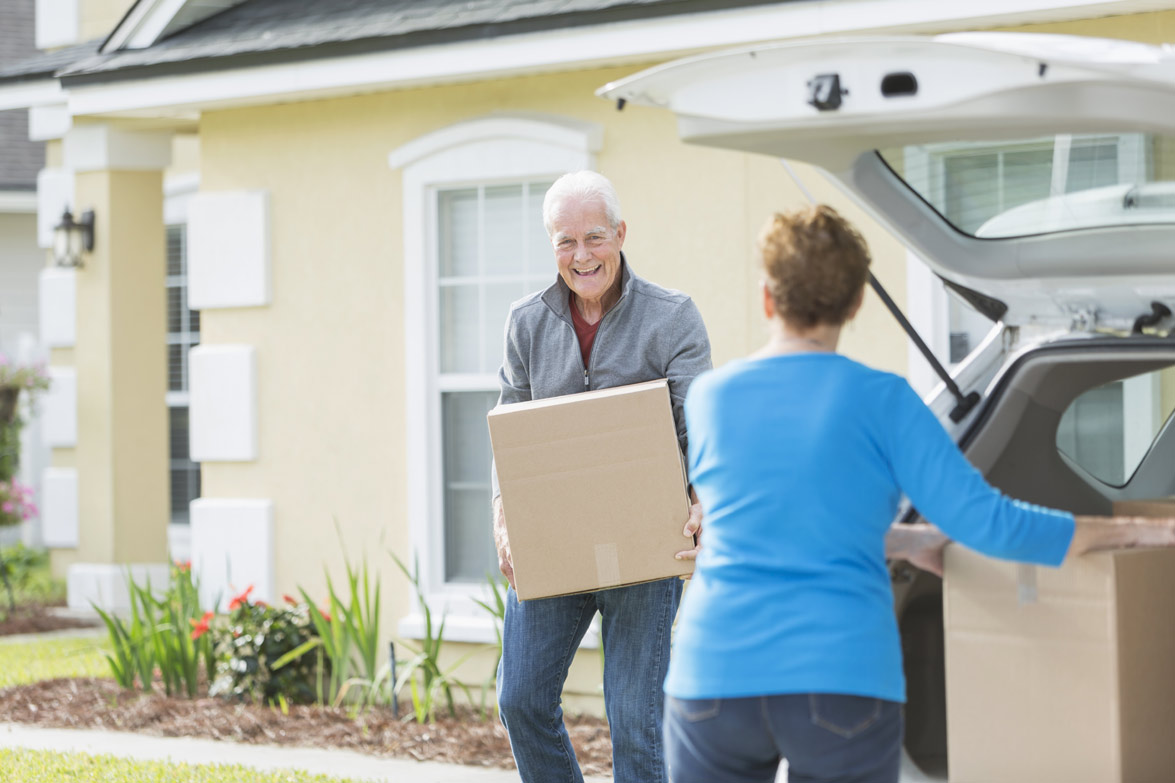 Older Couple Moving in House